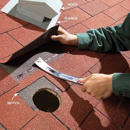 <b>Photo 2: Trim back shingles</b></br> Notch out the upper layer of shingles to fit around the vent's hood. Remove any nails that will stop the vent's flange from slipping under the shingles.