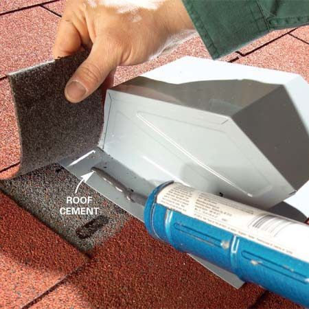 <b>Photo 4: Set the vent hood</b></br> Slide the hood under the shingles. Cement the shingles to the vent's flange. Fasten the lower edge of the flange with roofing nails.