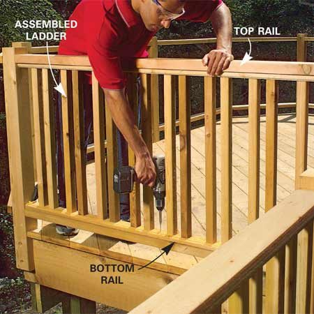 <b>Photo 9: Install the assembled ladders</b></br> Slide the assembled ladder between the top and bottom rails. Screw through the plate into both top and bottom rails with 2-in. screws to secure.