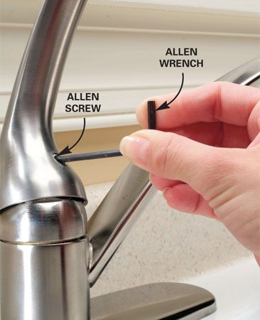 <b>Step 1: Loosen the Allen screw</b></br> Photo 1: Lift the handle and pry off the decorative cover to expose the Allen screw. Turn the screw counterclockwise until it's loose enough to lift the handle up from the stem.