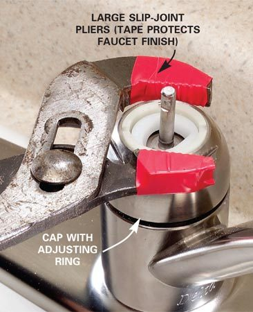 <b>Step 2: Remove the cap</b></br> Photo 2: Unscrew the cap by turning it counterclockwise with a slip-joint pliers.