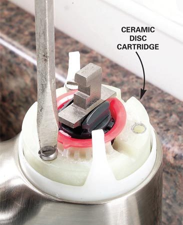 <b>Step 2: Remove the disc cartridge</b></br> Photo 2: Remove the screws that hold the disc cartridge to the faucet body and lift out the cartridge.