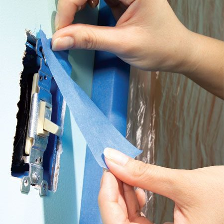 <b>Photo 4: Keep electrical devices paint-free</b><br/>Paint slopped on electrical cover plates, switches and outlets looks tacky. Don&#39;t try to paint around them. Removing cover plates takes just a few seconds and makes for a faster, neater job. Grab a small bucket to hold all the odds and ends you&#39;ll take off the walls. Unscrew cover plates and then shield each switch or outlet with 2-in.wide masking tape. Also remove curtain hardware, picture hooks, grilles that cover duct openings and anything else that might get in your way. The thermostat is one exception&mdash;it&#39;s easier to wrap it with masking tape than to remove and reinstall it.