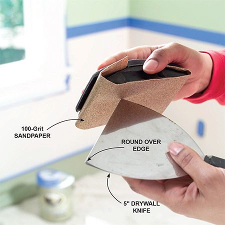 <b>Photo 1: Modify a drywall knife</b></br> Round the corners of a standard 5-in. drywall knife to prevent the tool from digging in.
