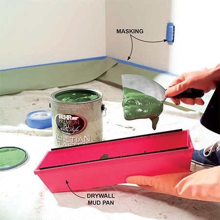 <b>Photo 2: Work from a drywall pan</b></br> Transfer the Venetian plaster mix to a drywall pan so it's easier to scrape the excess off the knife. The plaster is a bit thinner than drywall compound but thicker than paint.