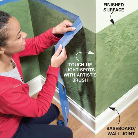 <b>Photo 8: Remove the tape</b></br> Pull the painter's masking tape gently from the wall to avoid lifting the paint beneath. Using your utility knife, carefully cut the texture along the joint where the baseboard meets the wall. This will allow you to easily peel back the tape.