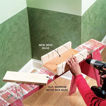 <b>Photo 1: Widen the miter box, if necessary</b></br> Hand miter boxes and fine-tooth hand saws are best for cutting urethane moldings. The moldings, however, are often wider than the miter box bed. Widen the bed by removing the screws on the side of the box and adding a wider base. To widen your miter box as shown in Photo 1, use a hammer to tap the sides free of the original base. Drill pilot holes and screw the sides to the new base. With the wider base, you'll be able to crosscut and bevel-cut the moldings. However, the other miter operations won't be possible, since the precut slots will no longer line up. This won't be a problem for cutting the moldings we show here.
