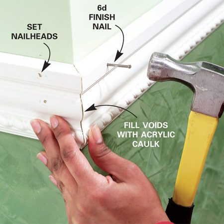 <b>Photo 3: Nail the molding</b></br> Glue and nail the moldings to the wall. Make small reference marks along the wall with your level to make sure you keep the molding straight as you nail. Set the nails with a nail set.