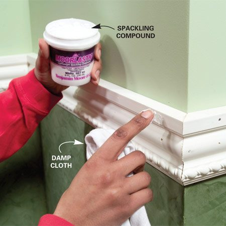 <b>Photo 4: Fill the holes</b></br> Fill the nail holes with spackling compound and the joints with acrylic caulk, then wipe with a slightly damp cloth. You'll need a second application once the spackling compound and caulk are dry. Wipe smooth or lightly sand, then paint.