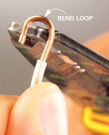 <b>Photo 1: Bend wire for a screw connection</b></br>