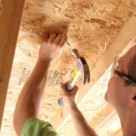 <b>Photo 1: Mark vent locations</b></br> Center nails between rafters 18 in. from the roof's peak. Drive nails up through the sheathing and shingles to mark vent locations.