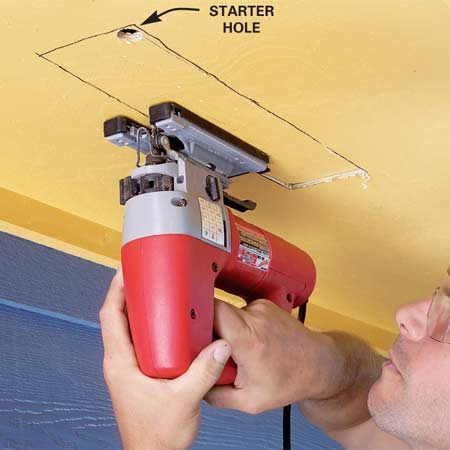 <b>Photo 7: Cut soffit vent holes</b></br> Cut holes for soffit vents with a jigsaw. Make the hole dimensions 1 in. smaller than the length and width of the vent.