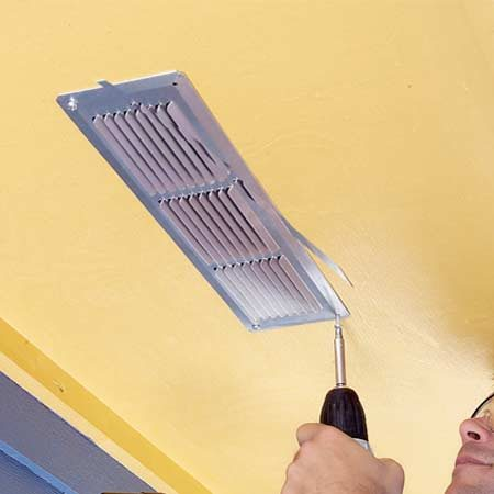 <b>Photo 8: Install the vents</b></br> Screw soffit vents into place with the fins pointing toward the house. Prime and paint vents to match the soffit, but don't plug the inner screen with paint.