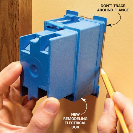 <b>Photo 5: Mark the new box</b></br> Trace the profile of the new box onto the wall with one side held along the stud. Use a sharp pencil. Don't trace or cut around the flanges!