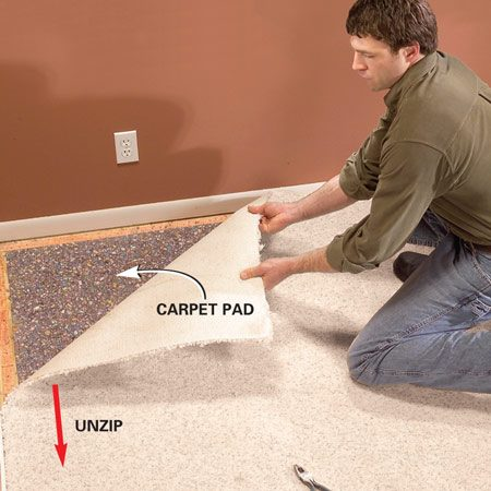 <b>Photo 1: Peel back the old carpet</b></br> Lift a corner of the carpeting free of the tack strip with a pliers. then peel back the carpet. Once it's started, it'll release easily, like pulling on a zipper.