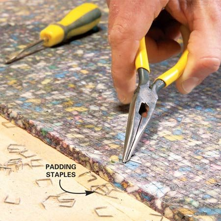 <b>Photo 2: Pull stapes</b></br> Dig the staples out of the carpet pad with a screwdriver or needle-nose pliers. Be patient and get them all. Otherwise the pad will rip.