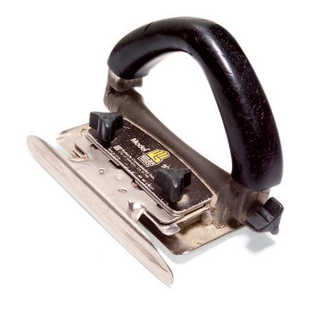 <b>Carpet cutter</b></br> A carpet cutter trims the carpet even with the wall or baseboard (Photo 10).