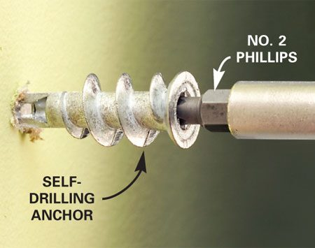 <b>Photo 1: Snug in the anchor</b></br> Center the anchor point on your mark and spin it in with a drill or by hand. Slow down when the large threads engage, and stop when the anchor is snug and nearly flush.