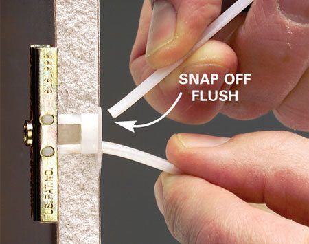<b>Photo 3: Bend</b></br> Bend the plastic straps and snap them off flush to the wall.