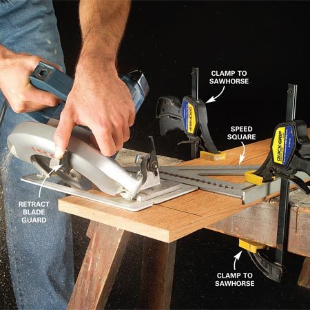 <b> Miter cut on a wide board</b></br> Clamp your workpiece for bevel cuts. Then retract the blade guard to start the cut. Release it as soon as the blade is fully engaged in the wood.