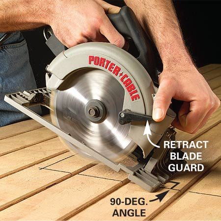 <b>Photo 1: Position the saw</b></br> Hold the front edge of your saw bed down firmly. Lift the blade guard with one hand and sight down the blade to align it with your line.