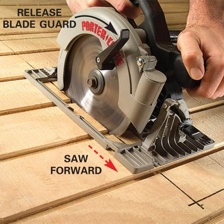 <b>Photo 3: Cut forward</b></br> When the saw bed contacts the work surface, release the blade guard and cut forward. Let the blade fully stop before lifting it from the cut.