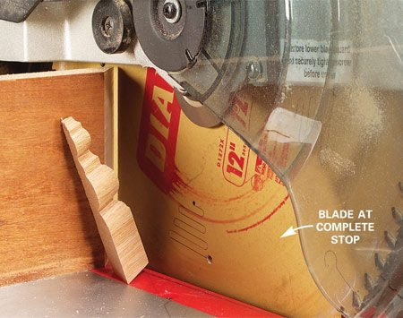 <b>Photo 3: Let the blade stop</b></br> Complete the cut and release the switch. Now here's the key. Let the blade come to a complete stop before you raise it.