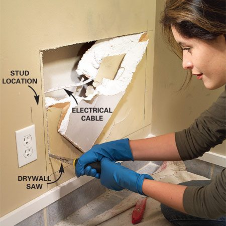 <b>Step 1: Check for wires</b></br> Photo 1: Draw a rectangle around the break with a straightedge or square. Look or put your hand through the break to feel for wires or other obstructions. Then cut out the section with a drywall saw or utility knife.