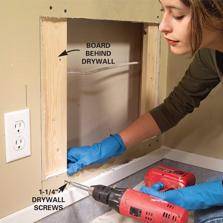 <b>Step 2: Insert backer boards</b></br> Photo 2: Insert 1x4 backer boards at each end of the hole and drive a pair of 1-1/4-in. drywall screws through the drywall into the boards to anchor them. Fit and screw a drywall patch to the boards.