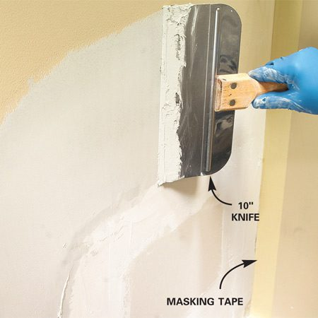 <b>Step 4: Apply a second and third coat</b></br> Photo 4: Apply a second coat of compound, drawing it at least 6 in. beyond the edge of the first coat to taper the edges of the repair. Let dry, then add a third coat to smooth any remaining uneven areas.