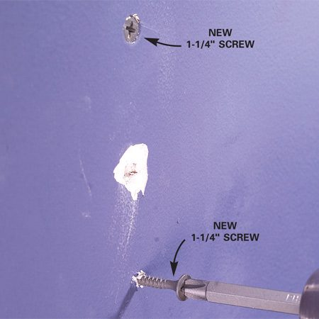 <b>Step 2: Drive in drywall screws</b></br> Photo 2: Drive drywall screws about 1-1/2 in. above and below the popped nail. Sink the screwhead just below the surface of the drywall.