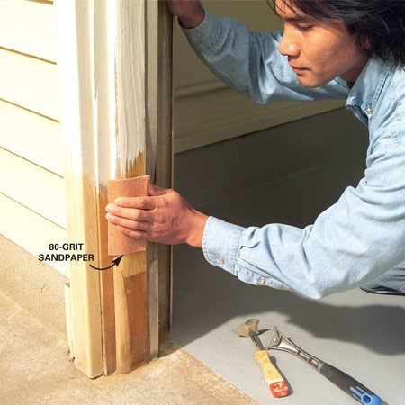 <b>Photo 2: Use sandpaper for better adhesion</b></br> Sand remaining paint off curves or in corners where scrapers don't reach. Coarse sandpaper, 60 or 80 grit, removes paint quickly and leaves a rough surface for better primer adhesion.