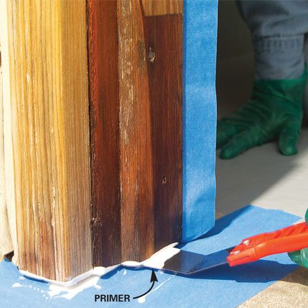 <b>Photo 6: Mask the concrete and prime the trim</b><br/>Coat the underside of the trim with primer using a bent putty knife. When the primer is dry, fill joints and nail craters with acrylic caulk.
