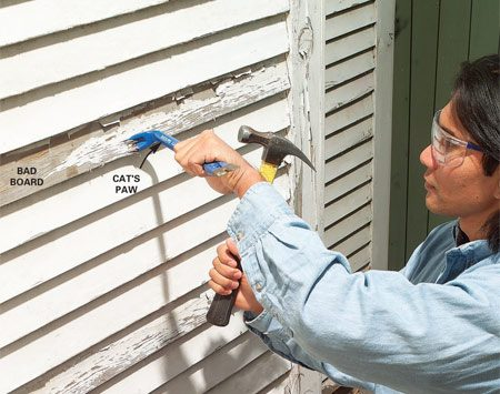 <b>Photo 1: remove the bad piece of siding</b></br> Dig nails out of bad boards by driving a cat's paw under the nailhead and pulling. Then nudge the board above outward with a pry bar.