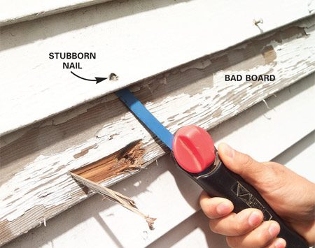 <b>Photo 2: Cut the nails above</b></br> Pull the nails in the board above carefully. Slide a hacksaw blade under the siding and cut any stubborn nails. Remove the bad board.
