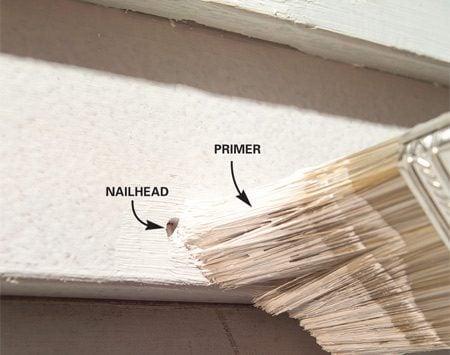 <b>Photo 5: Seal and fill the nail heads</b></br> Seal nailheads and craters with primer. Then fill the craters with caulk. You can apply acrylic paint right over acrylic latex caulk—no primer needed.