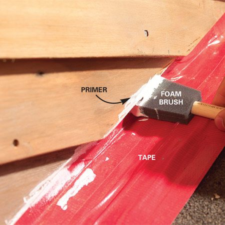 <b>Photo 5: Seal and prime</b></br> Seal the cut ends with water repellent followed by primer so they can't soak up water. Treat the faces of the siding the same way. Protect the flashing and shingles with tape.