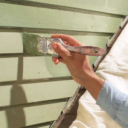 <b>Photo 6: Apply the paint</b></br> Finish the primed siding with two coats of paint. Duck down occasionally and check the undersides of the siding—it's easy to miss spots where the boards overlap.