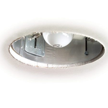 <b>Tight fit around electrical fixtures</b></br> Use a spiral saw to get a perfect fit for recessed lights in drywall. You don't need exact measurements.