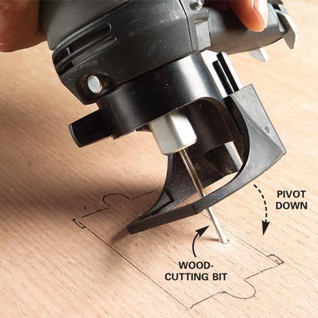 <b>Photo 1: Pivot the bit into the wood</b></br> Rest the base of the tool on the surface at a 45-degree angle. With the motor running, tilt the tool up while pivoting the bit into the wood.