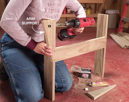 <b>Photo 4: Attach the arm supports</b></br> Align the arm supports with the top and front edges of the legs, then drill and screw each front leg to the arm support with two 1-5/8 in. deck screws.