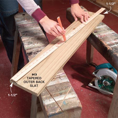 <b>Photo 7: Cut the back slats</b></br> Mark a diagonal line on H3, then clamp the board to your sawhorses and cut along the line to make a pair of outer back slats.