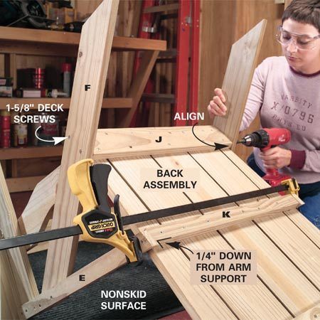 <b>Photo 9: Screw the back to the frame</b></br> Align the bottom of the back assembly with the seat braces and the tops of the rear legs. Screw the legs to the back brace and screw the horizontal arm supports to the center back brace.