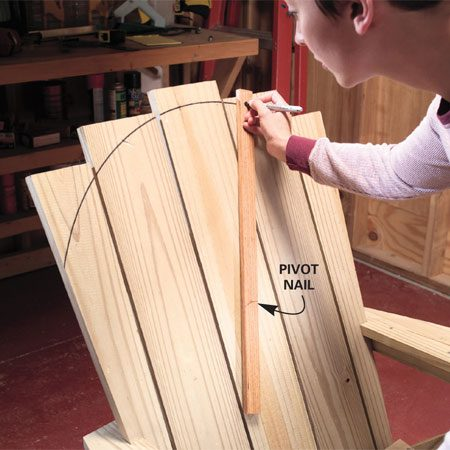<b>Photo 13: Mark and trim the back</b></br> Create a round back by measuring down 15 in. from the top and draw a 14-in. radius with a homemade compass.