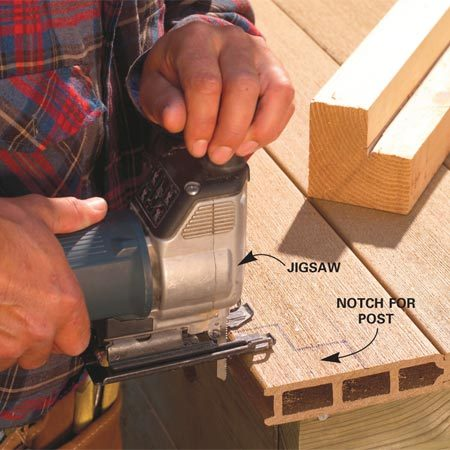 <b>Photo 13: Notch for the posts</b></br> Mark the corners and end post locations on the decking. Notch out the decking with a jigsaw to allow the posts to fit tight to the joists.