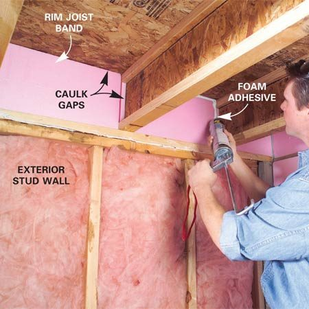 <b>Photo 2: Caulk gaps</b></br> Caulk all gaps and seams between the framing and the foam along the rim joists with more foam to seal potential air leaks.