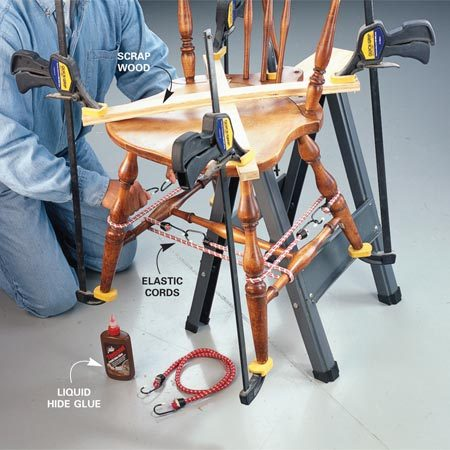<b>Photo 3: Reglue and clamp</b></br> Clamp the joints to ensure a tight bond. Improvise using a combination of elastic cords, clamps, wood scraps and other devices to clamp the entire seat/leg assembly first.
