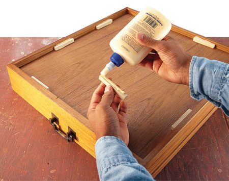 <b>Reinforce corners</b></br> When the backside of a joint is out of sight, glue blocks make great reinforcement. Cut 1/4-in. x 1/4-in. strips of wood, then cut the strips into shorter lengths. Use plenty of glue on each contact surface, and press the blocks firmly in place where they won't interfere with a drawer's movement. This is one of the few times you won't need clamps when gluing, since there's very little stress on the joint.