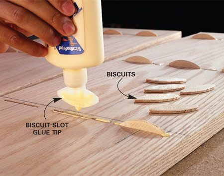 <b>Photo 2: Glue</b></br> Apply glue to all surfaces of the slots on both pieces. Insert the special biscuits in one side.