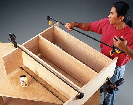 <b>Photo 3: Clamp</b></br> Slide the joining pieces over the biscuits, square up your project and clamp all joints firmly.